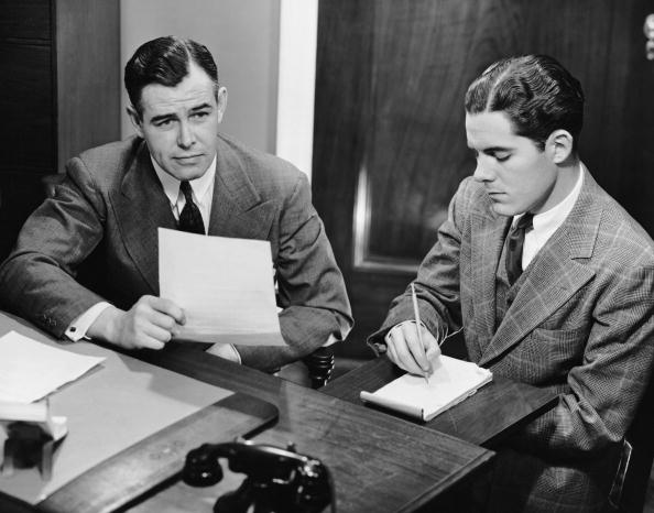 Male stenographer taking dictation