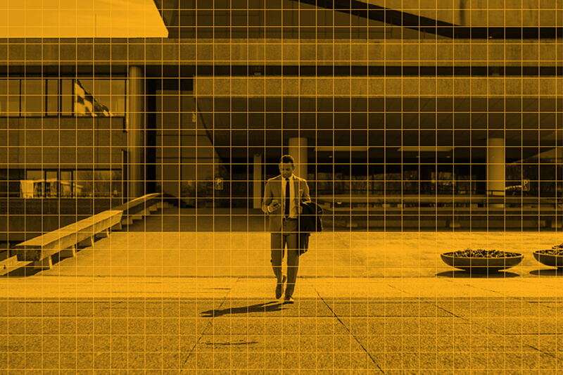 Man walking with a phone image